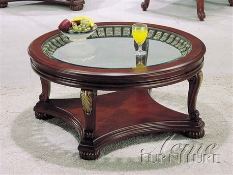 This coffee table features a glass and cherry wood veneer construction. Glass Top/Wood Kimberly Cherry Gold Coffee Table 08586A | The Classy Home