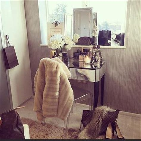 mirrored make up vanity with ghost chair transitional closet