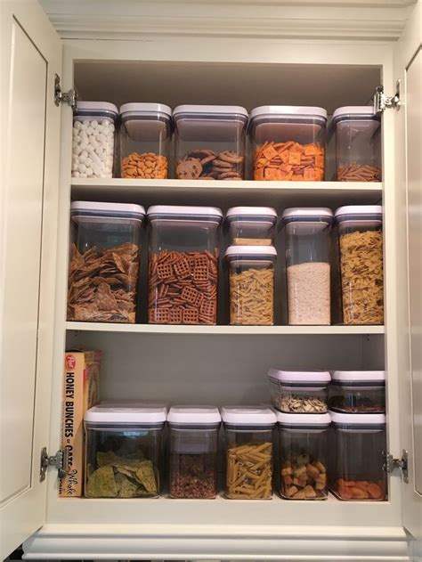 organize kitchen cabinets pinterest kitchen cabinet with oxo containers kitchen pantry