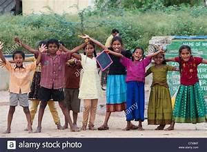 Happy young rural Indian village children laughing waving ...