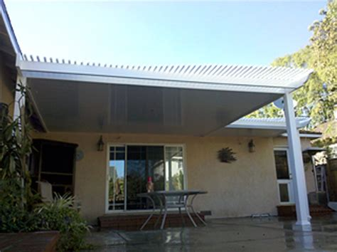 solid vinyl patio covers let you enjoy the sun without