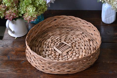 This basket already has a handy loop woven into the top of the basket for easy hanging on your wall for beautiful decorative wall art in your southwest home *although hand woven in traditional southwest designs. Round Wicker Basket / Wall Decor / Tan Decorative storage