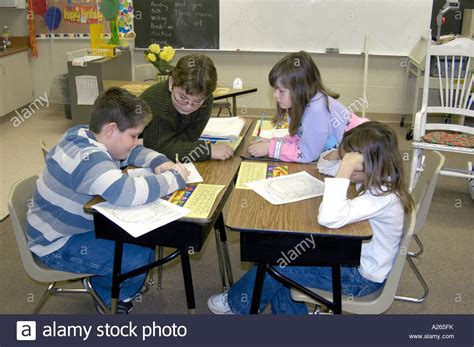 grade elementary students working  group helping