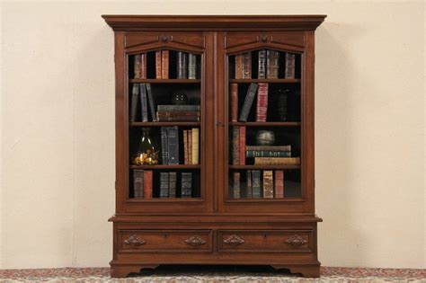 victorian  antique walnut bookcase wavy glass doors