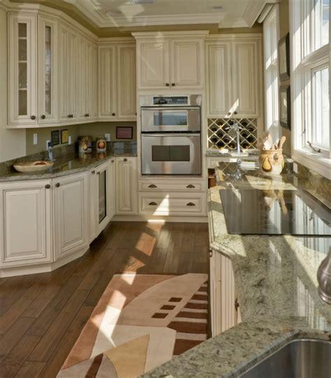 white and dark wood kitchen 35 striking white kitchens with dark wood floors pictures 656 | 6 white kitchen dark wood floor 870x993