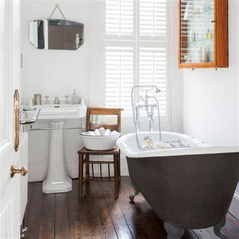 White bathroom with wooden floor   Bathroom decorating