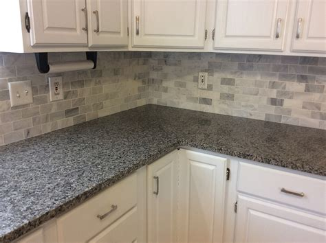 backsplash with white cabinets and light granite caledonia granite with backsplash tiles