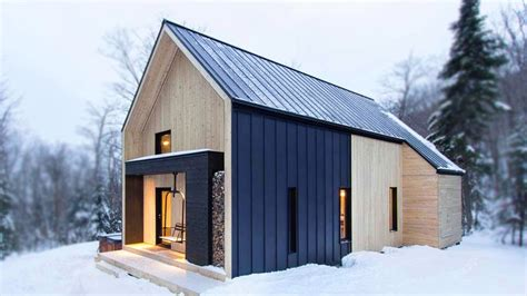 scandinavian inspired cottage surrounded  forest