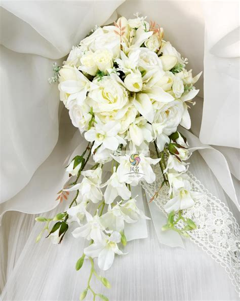 waterfall style handmade wedding bridal bouquet orchid