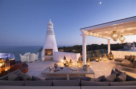 from the terrace overlooking the atlantic as the sun sets from the