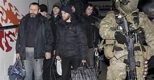 Ukraine's government and pro-Russian rebels swap prisoners