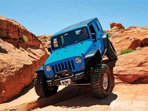 Blue Jeep On Rocks