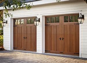 Clopay canyon ridge collection faux wood carriage house for Carriage style garage doors for sale