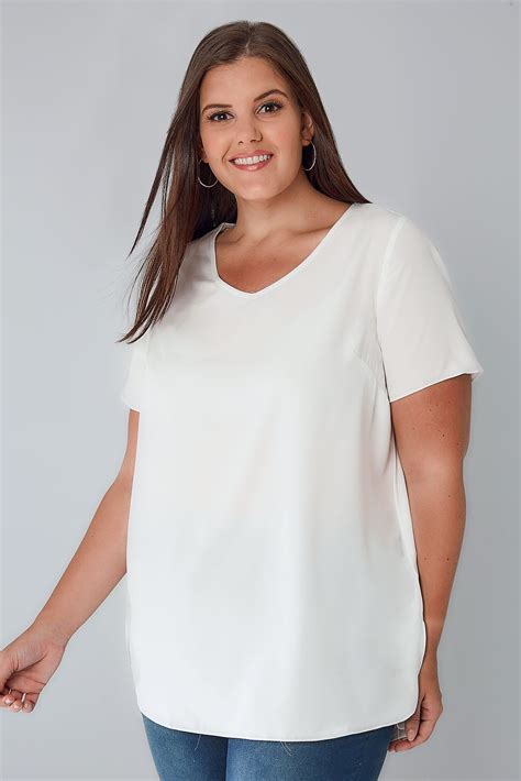 ivory woven top   neck curved hem  size