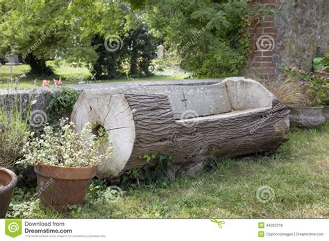 bench made out of a tree trunk stock photo image 44262318