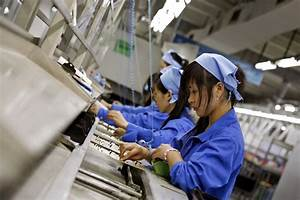 Chinese factory workers assemble electronics - ABC News ...