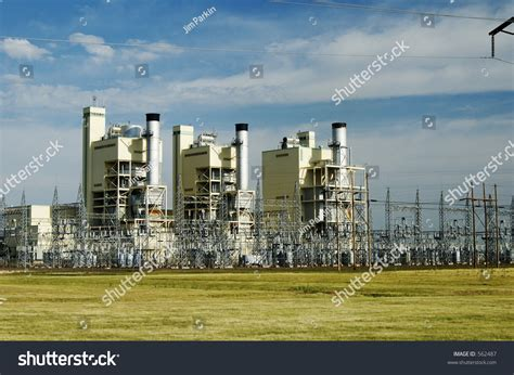 Electric Power Plant And Transmission Lines. Stock Photo