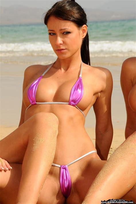 Four Bikini pleasure babes in tiny micro bikinis
