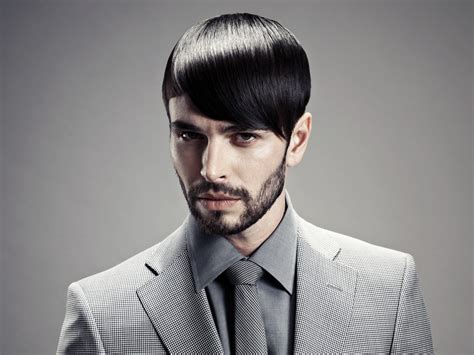 haircut with sleek styling for a man with a stubbly beard