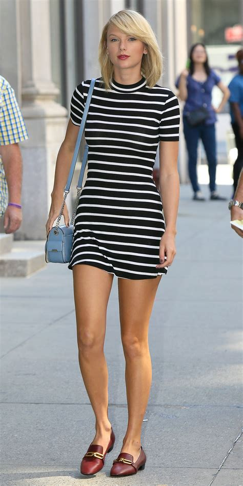 Taylor Swift Goes French Chic in a Black and White Striped ...