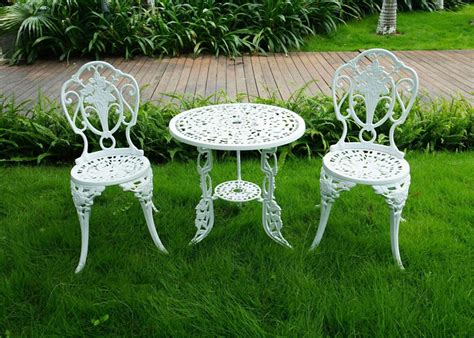 3 white bistro patio set table and 2 may chairs set