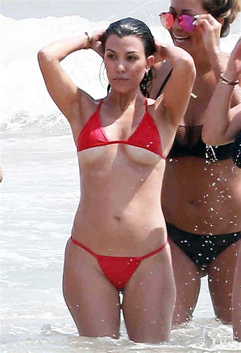 Kim And Kourtney Kardashian Flaunt Curves In Skimpy