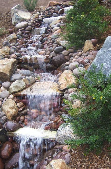 photo water feature   slope waterfalls backyard