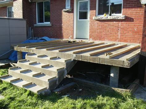 building a wooden deck a concrete one 6 steps with
