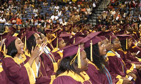 students accept diplomas  petersburg high school