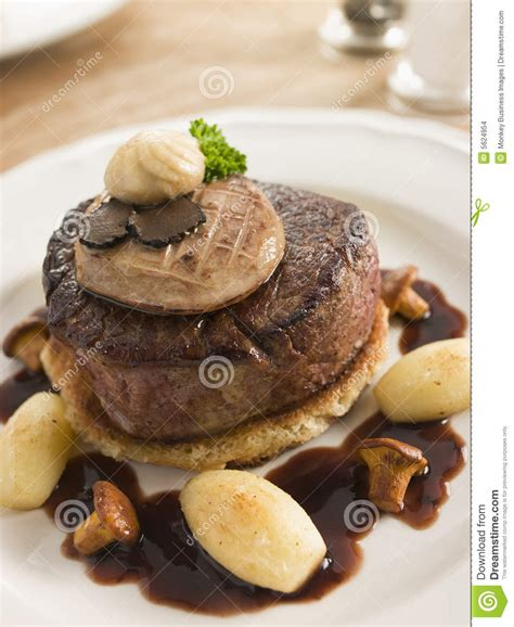 tournedos rossini with cocotte potatoes stock photo