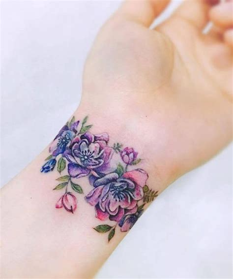 delightful flower wrist band tattoo designs  girls
