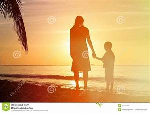 Silhouettes Of Mother And Son Holding Hands At Stock Photo ...