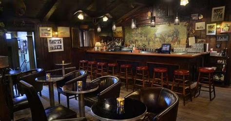 Bar Area by Escape The Cold At These 7 Cozy Saratoga Area Bars