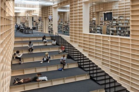 bookshelves stairs musashino museum and library by sou