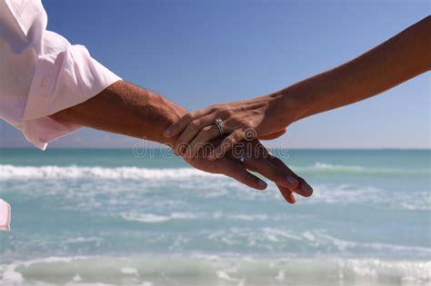 Miami Beach Wedding Rings And Arms Stock Photo