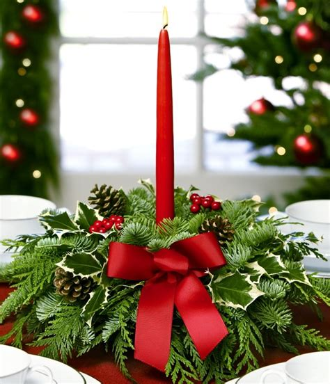 evergreen centerpiece with red candle christmas pinterest
