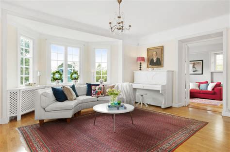 my livingroom needs help bay windows opposite fireplace