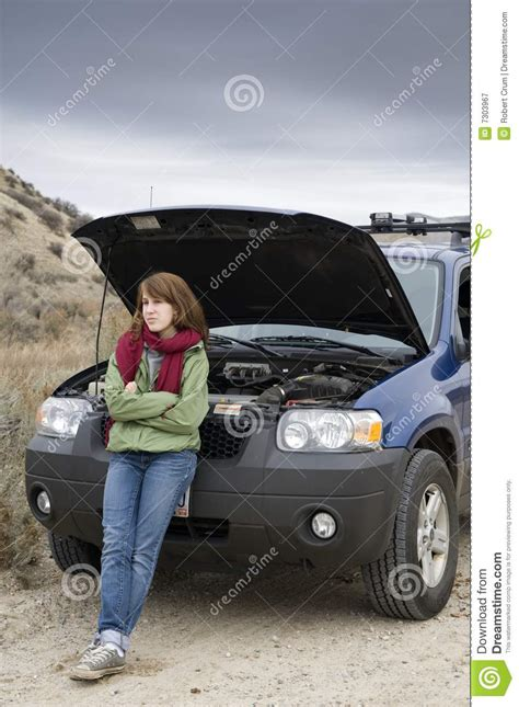 Teenage Girl With Broken Car Royalty Free Stock