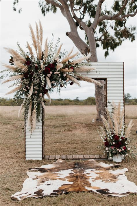 Iron Wedding Arch With Plumes Of Pampas Grass And Burgundy