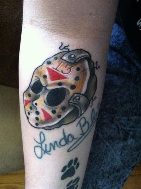 realistic grey ink jason  axe tattoo