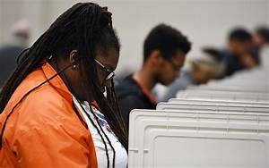 Georgia, Officials, Not, Immune, From, Suit, Over, Risky, Voting