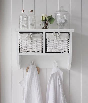 white wall shelf   baskets  hanging pegs hall