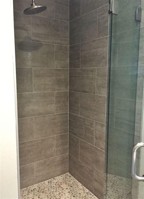 master shower  porcelain tile  walls pebbles