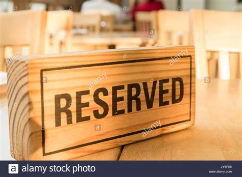 wooden reserved table signs reserved sign table stock photos reserved sign table