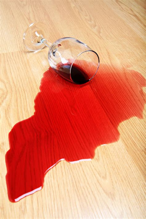 wine spilled  hardwood floor red wine glass