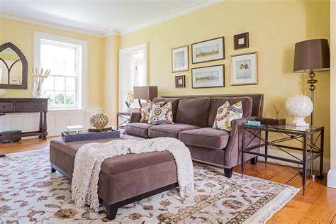 Living Room Yellow Walls by A Cheerful Traditional Living Room Featuring Yellow Walls