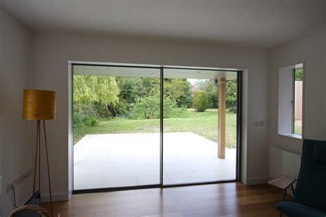 view through the minimal windows onto the garden