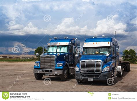 typical american blue freightliner trucks editorial