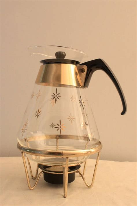 This flexible coffee maker, created by the inventors of the instant pot multicooker, accepts both popular brands of coffee capsules. Mid Century Modern Pyrex Instant Coffee Pot Carafe with Stand