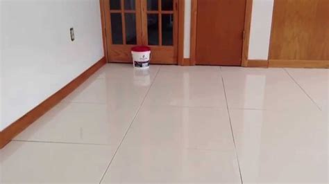 Installing 24x24 Porcelain Tiles by How To Grout Teppo Interiors White Polished Porcelain